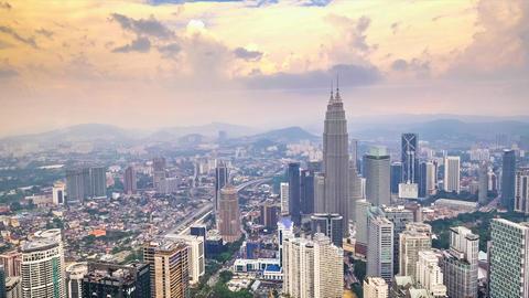 Cloudscape view city panorama with Petronas Twin Towers. Kuala Lumpur, Malaysia Live Action