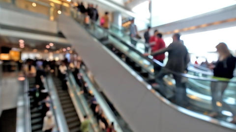 People on moving escalators at modern shopping mall, Hong Kong. Blur effect, unr Footage