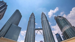 Cloudscape view of the Petronas Twin Towers. Kuala Lumpur, Malaysia Footage