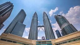 Cloudscape view of the Petronas Twin Towers. Kuala Lumpur, Malaysia Footage