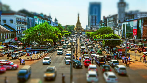 Yangon cityscape with busy highway and Buddhist shrine Sule pagoda. Myanmar Footage