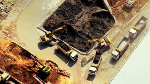 Excavators and tipper tracks working at construction. Hong Kong Footage