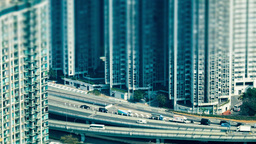 Time lapse aerial view of modern city busy highway. Hong Kong, tilt shift Footage