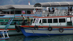 Passenger Ferry Arriving In Harbour,Lake Toba,Sumatra,Indonesia stock footage