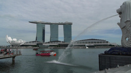 Marina bay and Merlion and tourist boat,Singapore Footage