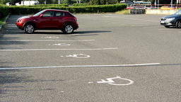 parking spaces in the parking lot for the disabled - busy urban street with pass Footage