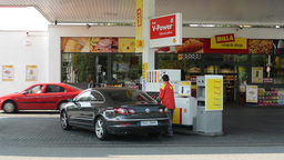 gas station (oil pump) Shell in the city - with cars and people - worker of gas  Footage