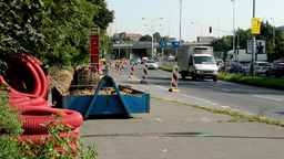 reconstruction the bus stop with workers - road with passing cars - bridge in th Footage
