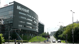 Microsoft headquarters - street with cars and people - nature (trees and grass)  Footage