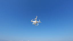 White Remote Controlled Drone Equipped With High Resolution Video Camera Hoverin stock footage
