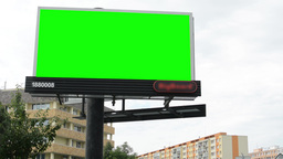 billboard in the city near road - green screen - buildings with trees in backgro Footage