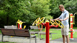 Senior Park (exercise Machines) With Benches - In The Park With Trees And Grass  stock footage