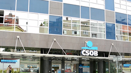 Bank exterior - CSOB (Czechoslovak Trade Bank) - urban street with passing cars Footage