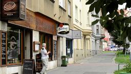 restaurant(pub) exterior - man leave the restaurant - urban street: cars in back Footage