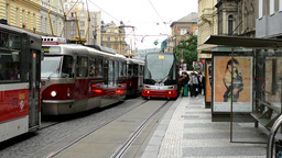 commuter people - people get in and get off from tram - city (buildings) with pa Footage
