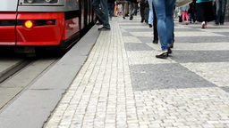 commuter people - people get in and get off from tram - city - detail of legs (p Footage