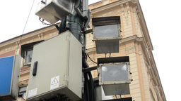 road radar and four security cameras on the street - building in background - cl Footage