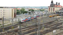 the train arrives into the main train station - panorama of the city with passin Footage