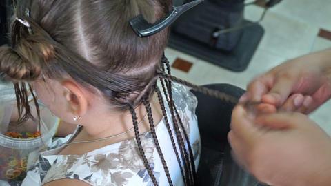 Hairdresser Hands Weaving A Dreadlocks stock footage