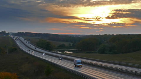 cars on highway road at sunset, timelapse, 4k Footage