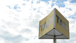 Taxi Sign - Cloudy Sky stock footage