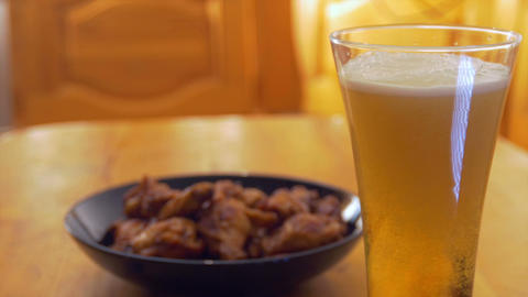 Roasted chicken wings and beer Stock Video Footage