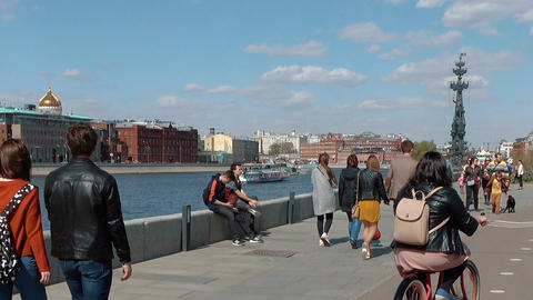 People stroll along the embankment of the Moscow River Footage