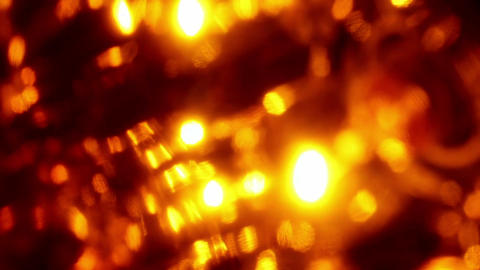 Seamless loop of soft focused orange LED lights blinking Footage