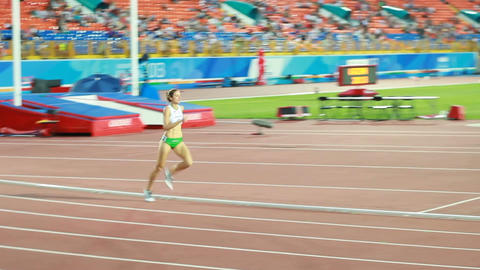Girl Athlete Runs on Track at International Competition Footage