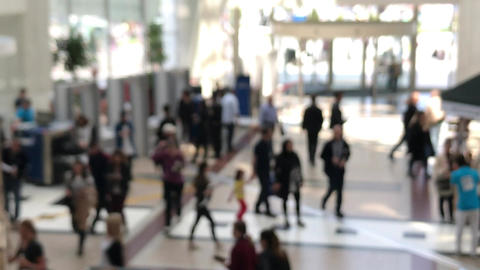 Blurry Customers entering the mall center through security and revolving doors Footage