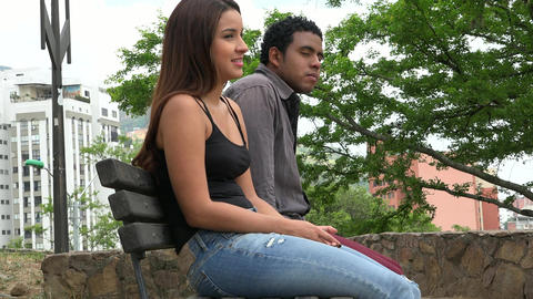 Man And Woman Sitting On Park Bench Live Action