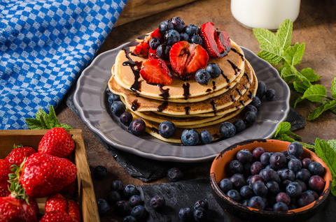American pancakes with berries and chocolate Photo