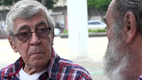 Elderly Man Listening To Friend Live Action