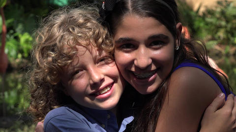 Teen Girl and Boy Hugging Live Action