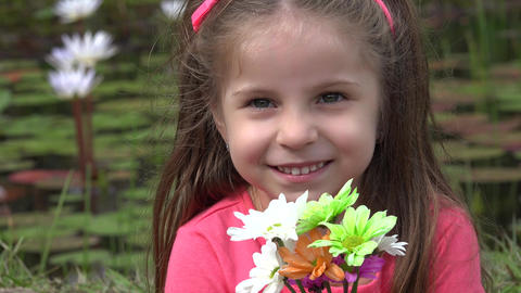 Adorable Toddler Girl With Flowers Live Action