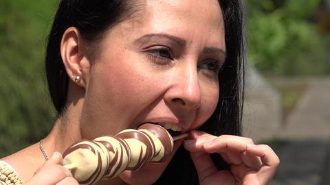 Hispanic Woman Eating Chocolate Dessert Footage