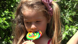 Toddler Girl With Lollipop Live Action