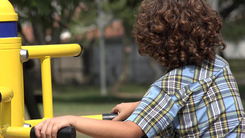 Curly Haired Boy at Playground Footage