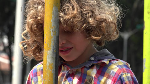 Curly Haired Boy During Summer Footage