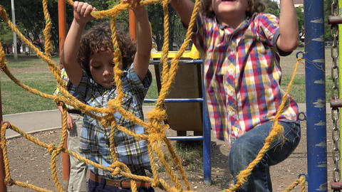 Boys Climbing Ropes at Playground Footage