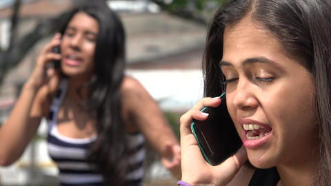 Teen Girls Arguing on Cell Phone Footage
