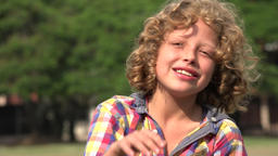 Curly Blonde Boy Pointing Footage
