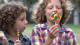 Brothers Eating Lollipop Candy Footage