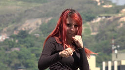 Young Redheaded Woman Practicing Martial Arts Footage