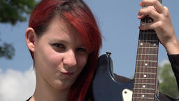 Redheaded Woman Posing With Guitar Footage