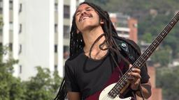 African Male Reggea Guitarist With Dreadlocks Live Action