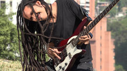 African Male Bass Guitarist With Dreadlocks Live Action