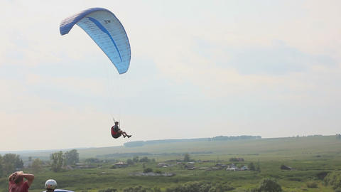 Paragliders in nature, close to the village Footage