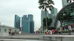 Singapore 061 skyscrapers seen at marina bay waterfront promenade Footage