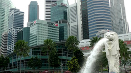 Singapore 063 water spouting lion head and skyscrapers Footage